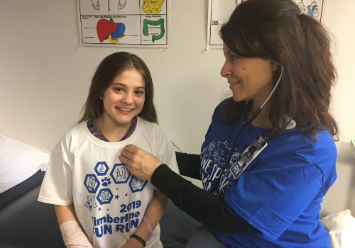 School nurse examines a student at Timberline Elementary School.