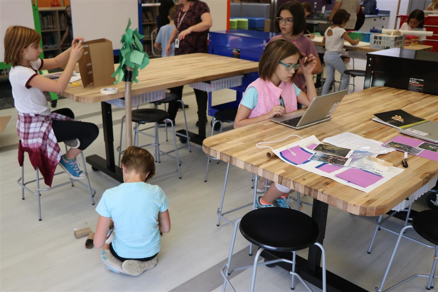 Students spread out and work on individual projects in school's new maker space.