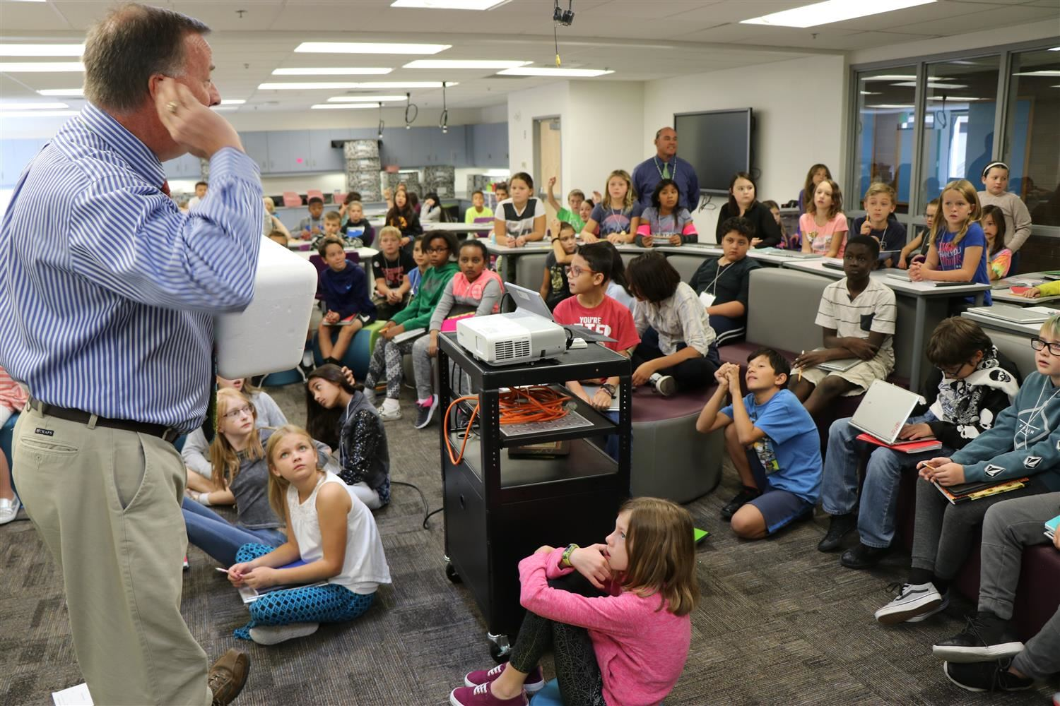 A teacher speaks to the entire class in their newly renovated library.