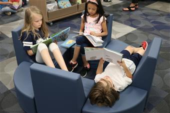 Students read in new innovation space.