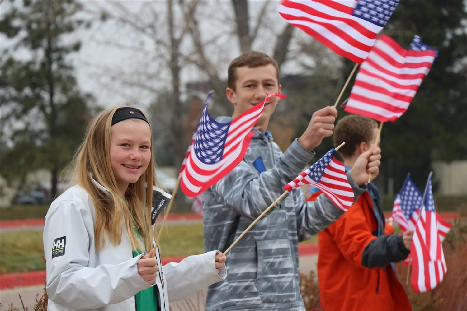 Students waving the flag outside