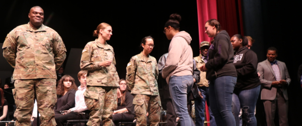 Smoky Hill High School students honor veterans on stage.