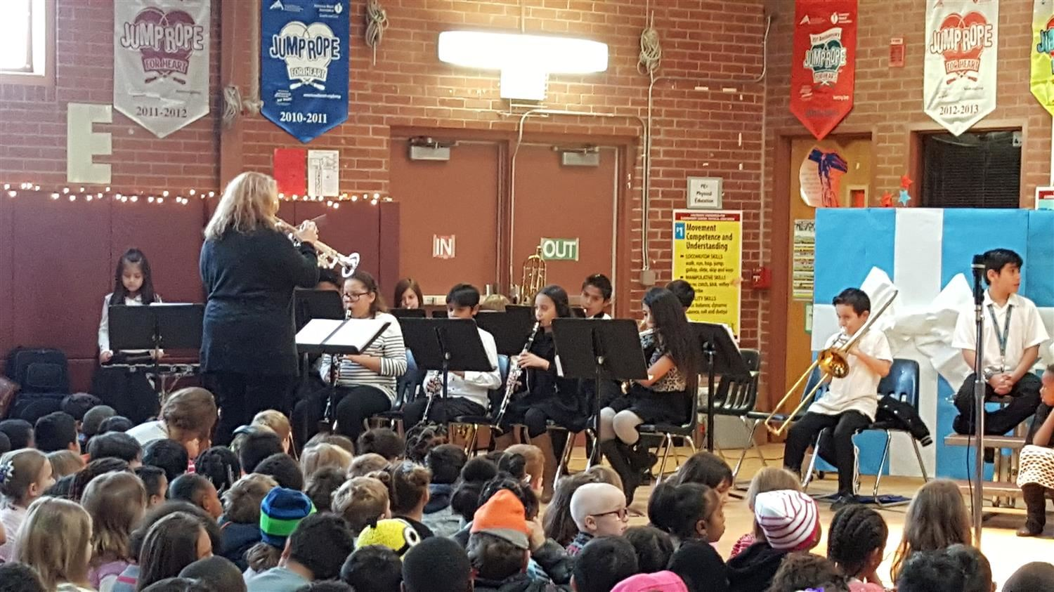 Band director leading students in school concert