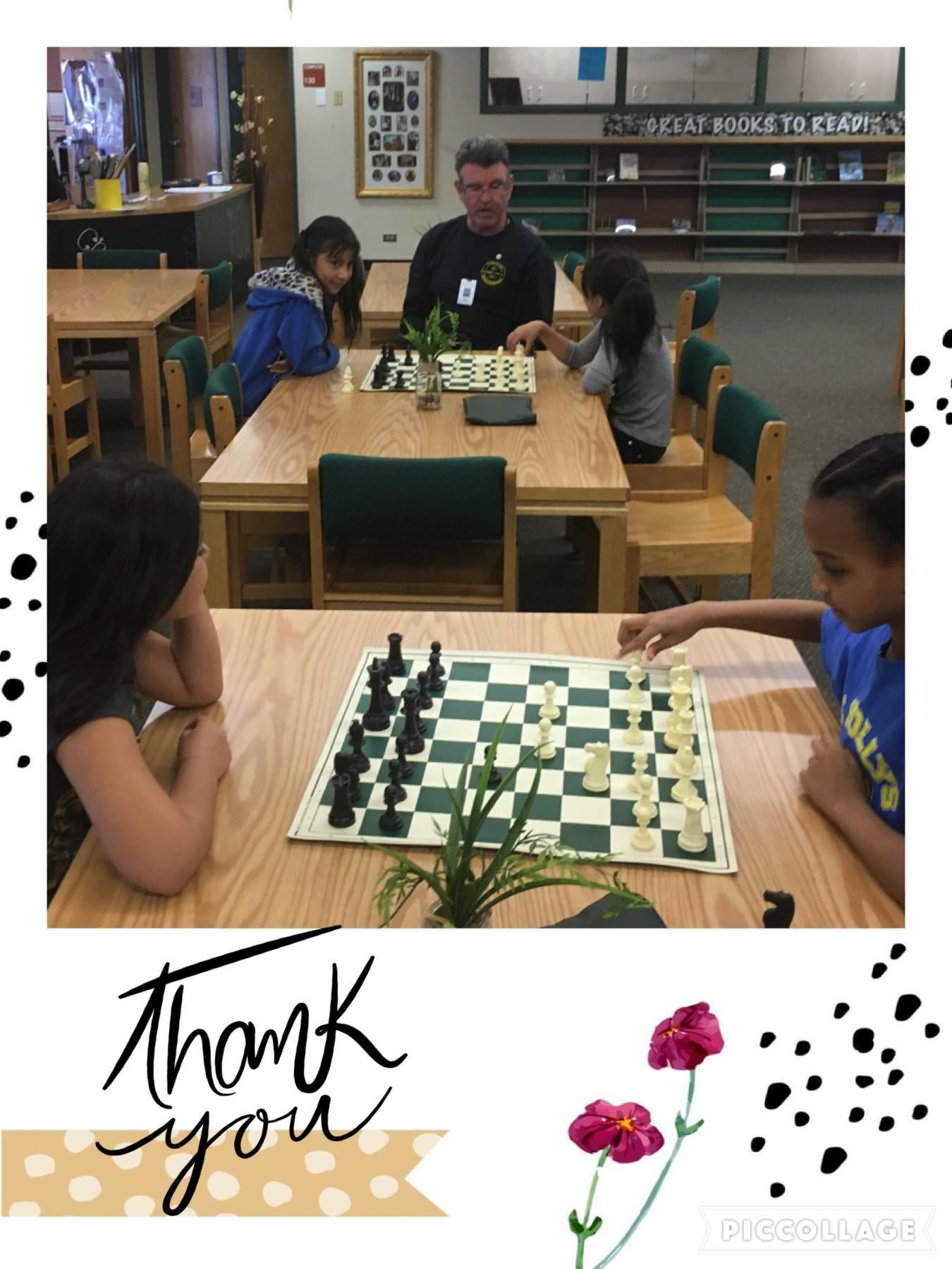 Man playing chess with students