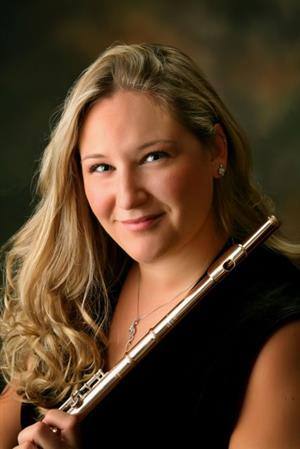 Picture of nicole ewing holding a flute