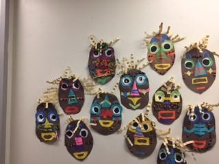 Student-made masks on a wall