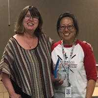 Jeannie Lei (right), receiving the CAER President's Award from CAER President Nancy Cozart.