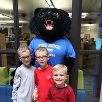 Pine Ridge Elementary students with Paws the Panther