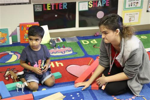 Fox Hollow Paraeducator Railya Izzayeva and student.