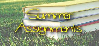 Books laying on grass with summer assignments written on top