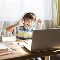 child at home in front of computer